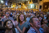 "Spain. Balearic Islands. Minorca (Menorca). Mahon. The crowd is packed at nightime in front of the City Hall during the opening ceremony of the  ""Festes de la Mare de Déu de Gràcia"", the most important summer festival in Mahon. Maó (in Catalan) and Mahón (in Spanish), written in English as Mahon, is a municipality, the capital city of the island of Menorca, and seat of the Island Council of Menorca. The city is located on the eastern coast of the island, which is part of the autonomous community of the Balearic. In Spain, an autonomous community is a first-level political and administrative division, created in accordance with the Spanish constitution of 1978, with the aim of guaranteeing limited autonomy of the nationalities and regions that make up Spain. 6.09.2019 © 2019 Didier Ruef"