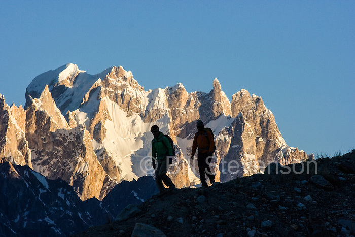 A silhouette of two women hikers on the Biafo glacier in the Karakoram Himalaya in Pakistan