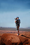 Professional photographer takes a photo in the desert