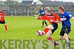 Tralee Dynamos Adam Piggot and Athlone Town's Owen Monaghan.