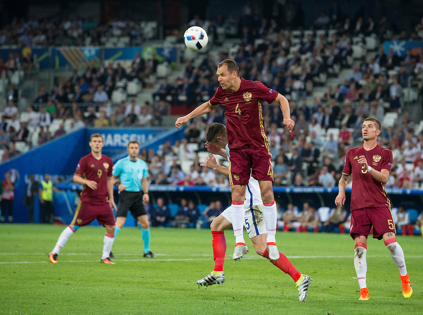 Russia's Sergei Ignashevich wins a header<br /> <br /> Photographer Craig Mercer/CameraSport<br /> <br /> International Football - 2016 UEFA European Championship - Group B - England v Russia - Saturday 11th June 2016 - Stade Velodrome, Marseille - France <br /> <br /> World Copyright &copy; 2016 CameraSport. All rights reserved. 43 Linden Ave. Countesthorpe. Leicester. England. LE8 5PG - Tel: +44 (0) 116 277 4147 - admin@camerasport.com - www.camerasport.com