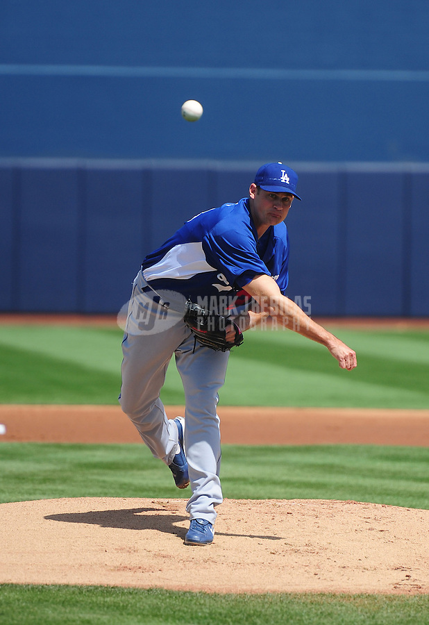 Mar. 27, 2012; Peoria, AZ, USA; Los Angeles Dodgers pitcher Jamey Wright throws in the first inning against the San Diego Padres at Peoria Stadium.  Mandatory Credit: Mark J. Rebilas-