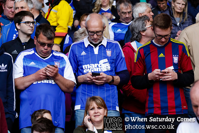 Nottingham Forest 3 Ipswich Town 0, 07/05/2017. City Ground, Championship. Ipswich fans in on their mobile phones before the game between Nottingham Forest v Ipswich Town at the City Ground Nottingham in the SkyBet Championship. Photo by Paul Thompson.