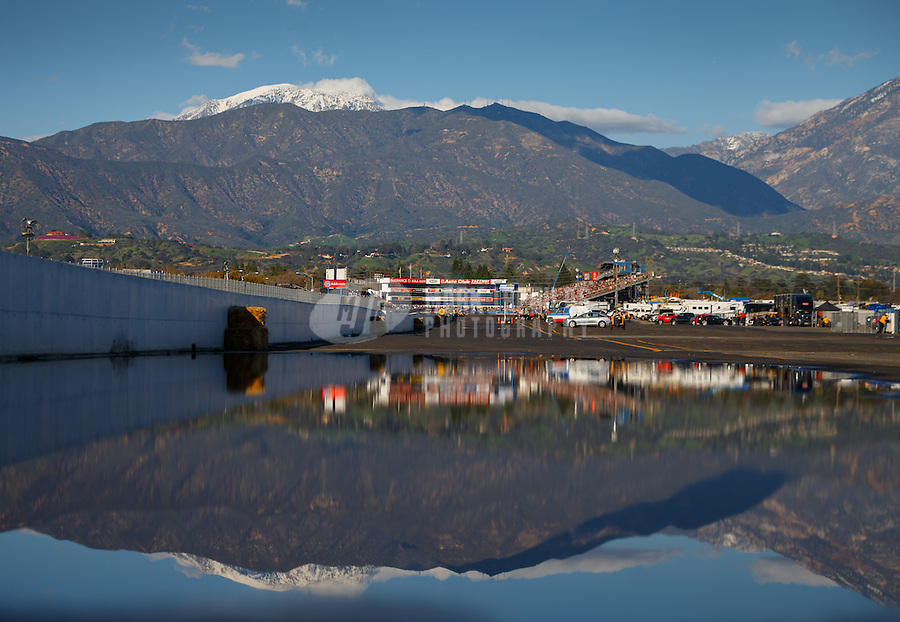 Feb 12, 2017; Pomona, CA, USA; Overall view of Auto Club Raceway at Pomona reflecting in a rain puddle during NHRA qualifying for the Winternationals. Mandatory Credit: Mark J. Rebilas-USA TODAY Sports
