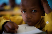 A child attends class in the compound of the Cluster resource Center of Lafaissa, Somali Region, Ethiopia on Monday November 9 2009. .The Lafaissa facility is supported by the British non governmental organization Save the Children UK..