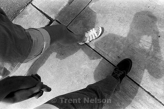 Trent Nelson and Laura Nelson holding hands. trent feet. trent shadow<br />