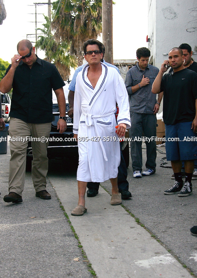 January 27th 2012...Charlie Sheen wearing a white bathrobe & slippers after filming a tv commercial for direct TV in Los Angeles California ...AbilityFilms@yahoo.com.805-427-3519.www.AbilityFilms.com..