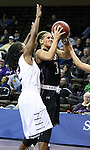 SIOUX FALLS, SD - MARCH 3:  Taylor Varsho #3 from the University of Sioux Falls takes the ball to the basket against Ameshia Kearney #2 from Concordia St. Paul in the first half of their semifinal game of the NSIC Tournament Monday night at the Sanford Pentagon. (Photo by Dave Eggen/Inertia)