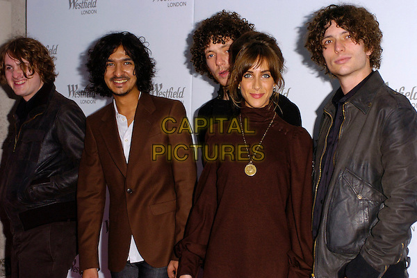 THE ZUTONS - ABI HARDING.Westfield Launch Party for London Fashion Week,.BFC Tent, Natural History Museum, London,.England, September 17th 2006..half length band group brown black polo neck dress gold necklace pendant .Ref: CAN.www.capitalpictures.com.sales@capitalpictures.com.©Can Nguyen/Capital Pictures