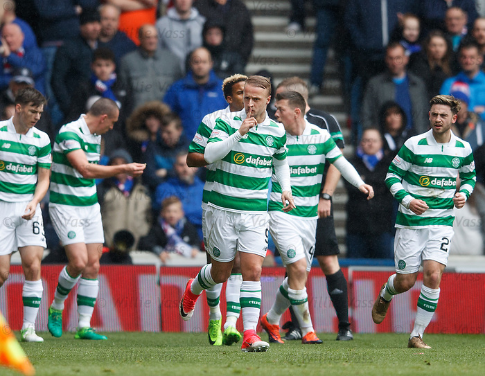 Leigh Griffiths celebrates his goal and gestures to the Rangers fans
