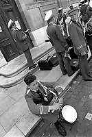 Switzerland. Geneva. Town Center. A groups of boys belonging to a fanfare gets ready to play in the streets on Music Day. A teen with a saxophone seats on the pavement while another boy practices his clarinet. The saxophone is a woodwind instrument usually made of brass and played with a single-reed mouthpiece similar to that of the clarinet. The player covers holes by pressing mechanical keys, triggering a system of pads, pivots, and linkages. The clarinet is a family of woodwind instruments. It has a single-reed mouthpiece, a straight, cylindrical tube with an almost cylindrical bore, and a flared bell. A fanfare is a short musical flourish that is typically played by various brass instruments. A marching band is a group in which instrumental musicians perform while marching often for entertainment. The Fête de la Musique, also known in English as Music Day, Make Music Day or World Music Day, is an annual music celebration that takes place on 21 June ( but usually during the previous or following weekend). On Music Day the citizens of a city or country are allowed and urged to play music outside in their neighborhoods or in public spaces and parks. Free concerts are also organized, where musicians play for fun and not for payment. 22.06.1993 © 1993 Didier Ruef