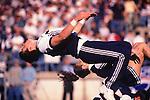 Penn State Cheerleader doing a back flip.