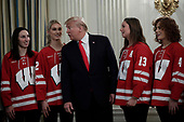 United States President Donald J. Trump poses with athletes from the University of Wisconsin-Madison Women's Hockey Team as part of NCAA Collegiate National Champions Day at the White House in Washington on November 22, 2019. <br /> Credit: Yuri Gripas / Pool via CNP