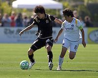 Eriko Arakawa (10) controls the ball against Aya Miyama (8). Los Angeles Sol defeated FC Gold Pride 2-0 at Buck Shaw Stadium in Santa Clara, California on May 24, 2009.