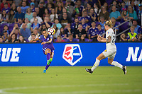 Orlando, FL - Saturday March 24, 2018: Orlando Pride defender Poliana Barbosa Medeiros (19) plays the ball up top during a regular season National Women's Soccer League (NWSL) match between the Orlando Pride and the Utah Royals FC at Orlando City Stadium. The game ended in a 1-1 draw.