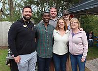 NWA Democrat-Gazette/CARIN SCHOPPMEYER Blake Pennington (from left), Quintin Canada, Ben Catterlin, Jenae Randall, Mackenzie Arnold and Diane Quick gather at the Bar & Grill.