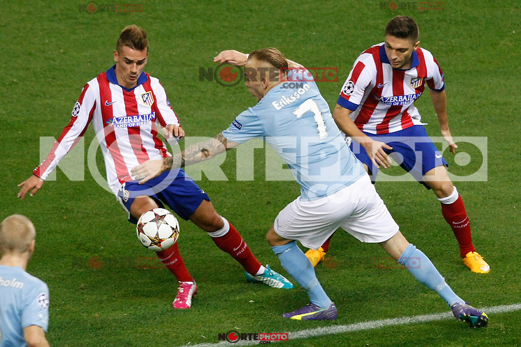 Atletico de Madrid´s Griezmann and Siqueira and Malmo´s Eriksson during Champions League soccer match between Atletico de Madrid and Malmo at Vicente Calderon stadium in Madrid, Spain. October 22, 2014. (ALTERPHOTOS/Victor Blanco)