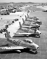 View of F-86 airplanes on the flight line getting ready for combat.  June 1951.  Air Force. (USIA)<br /> Exact Date Shot Unknown<br /> NARA FILE #:  306-PS-51-9760<br /> WAR & CONFLICT BOOK #:  1413