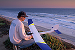 Gary Legerton flying radio glider at sunset+over the Pacific Ocean, Carlsbad, San Diego County, CALIFORNIA
