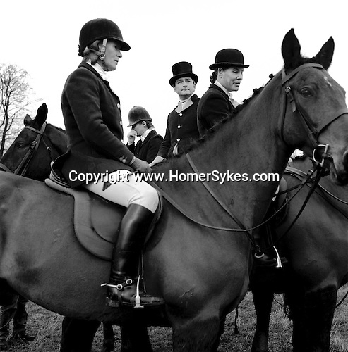 The Duke of Beauforts Hunt...The traditional Boxing Day Meet is held at Worcester Lodge, on the Badminton estate. It is usual for several hundred mounted followers and an equal number of foot followers to attend along with a TV crew or two, as well as a number of freelance photographers. Near Didmarton, Gloucestershire 2002...Hunting with Hounds / Mansion Editions (isbn 0-9542233-1-4) copyright Homer Sykes. +44 (0) 20-8542-7083. < www.mansioneditions.com >.