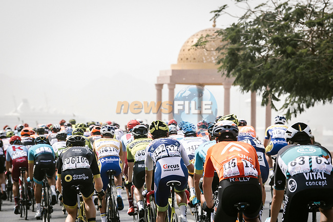 The peloton lined out during Stage 6 of the 10th Tour of Oman 2019, running 135.5km from Al Mouj Muscat to Matrah Corniche, Oman. 21st February 2019.<br /> Picture: ASO/P. Ballet   Cyclefile<br /> All photos usage must carry mandatory copyright credit (© Cyclefile   ASO/P. Ballet)