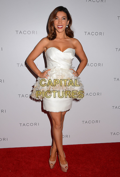 Adrianna Costa<br /> Celebrity arrivals at Tacori's Annual Club Tacori 2013 Event at Greystone Manor in West Hollywood, California, USA.<br /> October 8th, 2013<br /> full length dress white strapless feathers peplum hands on hips<br /> CAP/ADM/BT<br /> &copy;Birdie Thompson/AdMedia/Capital Pictures