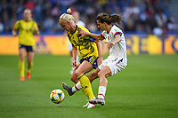 LE HAVRE, FRANCE - JUNE 20: Caroline Seger #17, Tobin Heath #17 during a 2019 FIFA Women's World Cup France group F match between the United States and Sweden at Stade Océane on June 20, 2019 in Le Havre, France.
