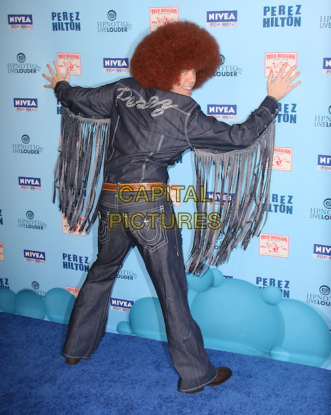 PEREZ HILTON (Mario Armando Lavandeira, Jr.) .attends Perez Hilton's Blue Ball held at Siren Studios in West Hollywood, California, March 26th 2011..full length blue red wig afro hair double denim shirt jeans  brown belt     costume tassels sleeves fringed flares seventies  back rear  behind name writing .CAP/RKE/DVS.©DVS/RockinExposures/Capital Pictures.