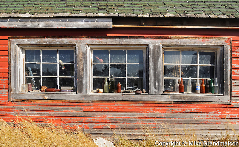 Old bottles on window sill of old farm building<br /> Laverna<br /> Saskatchewan<br /> Canada
