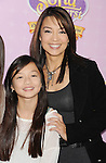 """BURBANK, CA - NOVEMBER 10: Ming Na and daughter arrive at the Disney Channel's Premiere Party For """"Sofia The First: Once Upon A Princess"""" at the Walt Disney Studios on November 10, 2012 in Burbank, California."""