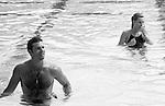 Lorenzo Lamas & Nicolette Sheridan in a pool at Battle of the Network Stars  in Malibu, California in 1986.