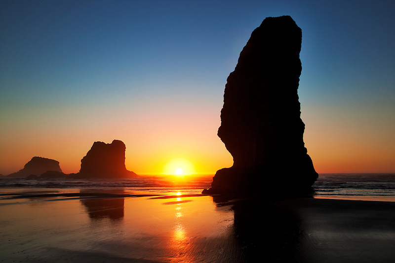 Monolith sea stacks and sunset at low tide. Samuel H. Boardman State Scenic Corridor. Oregon