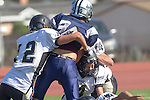 Torrance, CA 09/05/13 - AJ Hezlep (Peninsula #12), Josh Boykin  (North #3) and Jack Grimes (Peninsula #4) in action during the Peninsula vs North Junior Varsity football game played at North High School in Torrance, California.