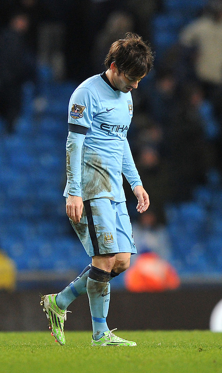 A dejected Manchester City's David Silva at the final whistle <br /> <br /> Photographer Dave Howarth/CameraSport<br /> <br /> Football - Barclays Premiership - Manchester City v Arsenal - Sunday 18th January 2015 - Etihad stadium - Manchester<br /> <br /> &copy; CameraSport - 43 Linden Ave. Countesthorpe. Leicester. England. LE8 5PG - Tel: +44 (0) 116 277 4147 - admin@camerasport.com - www.camerasport.com