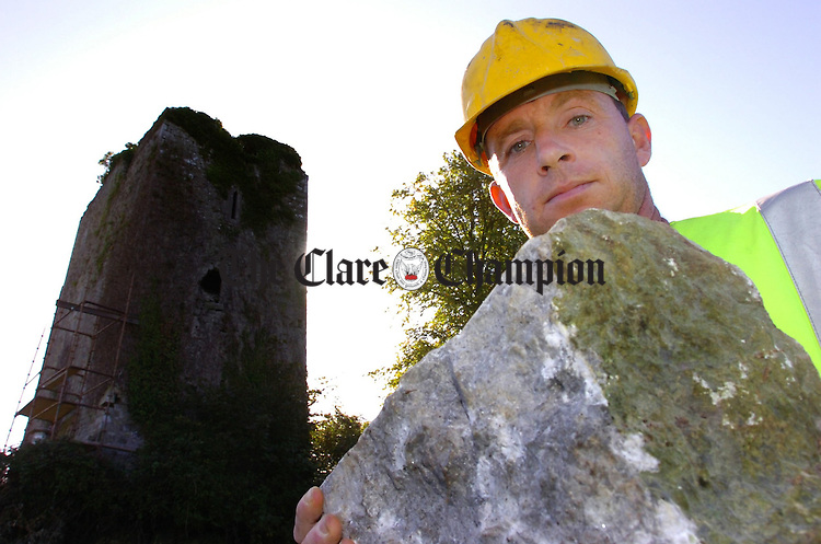 Stonemason Dave Buckley prepares a corner stone to be replaced during conservation work on the Watch Tower in Clonlara.Pic Arthur Ellis.