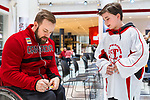 TORONTO, ON - FEBRUARY 11: Forward Billy Bridges autographs his hockey card for a young fan from the Elmvale Bears sledge hockey team as Hockey Canada reveals the players and coaching staff who will represent Team Canada in Men's Sledge Hockey at the upcoming Paralympic 2018 Winter Games in PyeongChang, South Korea on February 11, 2018 in the Atrium at the Canadian Broadcasting Corporation building in Toronto, Canada. (Photo by Adam Pulicicchio/Hockey Canada)