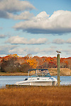 Patchogue River with motor boat in fall.