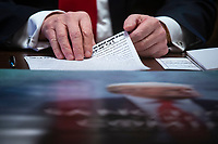 U.S. President Donald Trump looks over his notes during a cabinet meeting in the Cabinet Room of the White House, on Wednesday, Jan. 2, 2019 in Washington, D.C. Photo Credit: Al Drago/CNP/AdMedia
