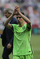 Jesus Navas of Manchester City thanks away supporters during the Swansea City FC v Manchester City Premier League game at the Liberty Stadium, Swansea, Wales, UK, Sunday 15 May 2016