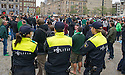 Police keep an eye on Celtic fans as they gather in Dam Square, Amsterdam, ahead of tonight's game against Ajax.