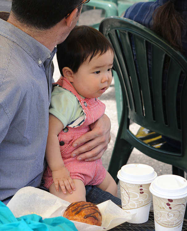 A young visitor enjoying the Opening Day of the 2017 Saugerties Farmer's Market on Saturday, May 27, 2017. Photo by Jim Peppler. Copyright/Jim Peppler-2017.