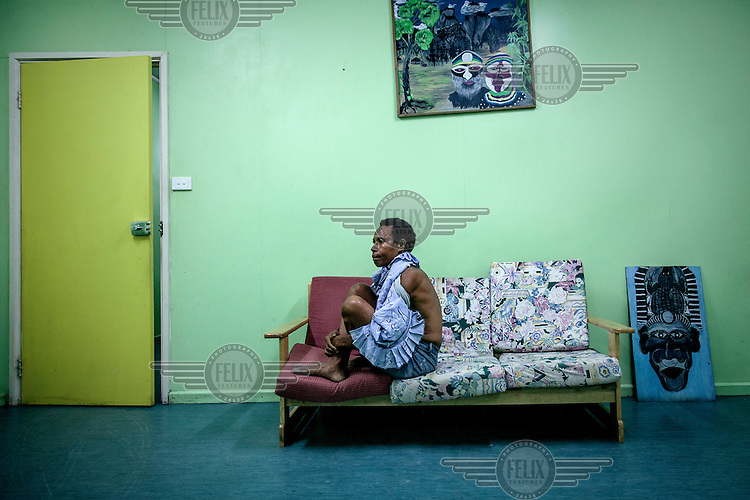 Molly, 42, waits for her medical examination at the Family Support Centre at Port Moresby General Hospital. Molly was brutally beaten by her husband, a security guard, who does not allow her to leave their house.