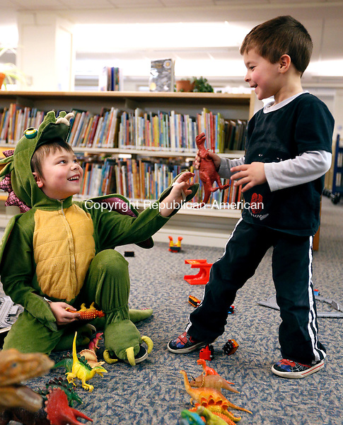 Southbury, CT- 14 January 2016-011416CM02  Jacob Skorupski 5, of Southbury, left, and and Daniel Candullo 5  share a laugh as they play with dinosaurs at the Southbury Public Library on Thursday.   The pair were at the library for a PJ Storytime event.  Skorupski wore his dragon pajamas.   Christopher Massa Republican-American
