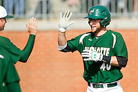 Ross Steedley #40 of the Charlotte 49ers high fives a teammate after hitting a solo home run against the Saint Peter's Peacocks at Robert and Mariam Hayes Stadium on February 18, 2012 in Charlotte, North Carolina.  Brian Westerholt / Four Seam Images