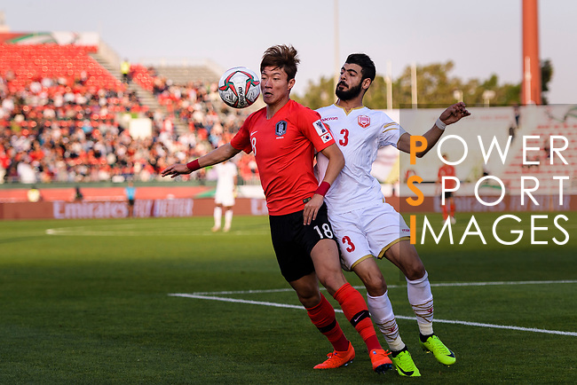 Hwang Uijo of South Korea (L) fights for the ball with Waleed Mohamed Alhayam of Bahrain (R) during the AFC Asian Cup UAE 2019 Round of 16 match between South Korea (KOR) and Bahrain (BHR) at Rashid Stadium on 22 January 2019 in Dubai, United Arab Emirates. Photo by Marcio Rodrigo Machado / Power Sport Images