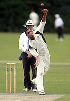 Vimal Arjan bowls for Wembley during the Middlesex County Cricket League Division Three game between North London and Wembley at Park Road, Crouch End on Sat Aug 2, 2014