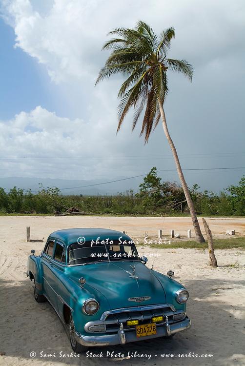Classic American car parked at Ancon Beach near Trinidad, Sancti Spiritus, Cuba.