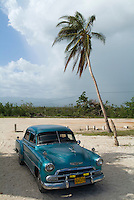 Classic American car parked at Ancon Beach near Trinidad, Sancti Spiritus, Cuba.