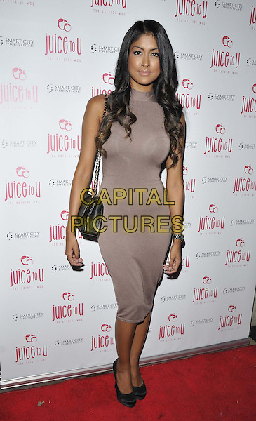 LONDON, ENGLAND - JULY 24: Farah Sattaur attends the JuiceToU 1st anniversary &amp; re-branding party, Sanctum Soho Hotel, Warwick St., on Thursday July 24, 2014 in London, England, UK. <br /> CAP/CAN<br /> &copy;Can Nguyen/Capital Pictures