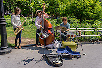 New York, NY 3 June 2015 Jazz band busking and selling their CD in Washington Square Park